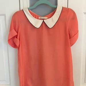 Cute short sleeve top, great for casual or office.